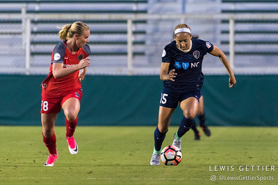 Amandine Henry (28) and Jaelene Hinkle (15) during a match between the NC Courage and the Portland Thorns in Cary, NC in Week 2 of the 2017 NWSL season. Photo by Lewis Gettier.