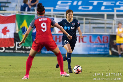 Nadia Nadim (9) and Yuri Kawamura (20) during a match between the NC Courage and the Portland Thorns in Cary, NC in Week 2 of the 2017 NWSL season. Photo by Lewis Gettier.