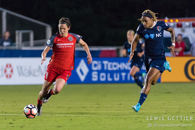 Emily Menges (4) and Jessica McDonald (14) during a match between the NC Courage and the Portland Thorns in Cary, NC in Week 2 of the 2017 NWSL season. Photo by Lewis Gettier.