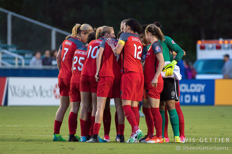 Portland Thorns huddle before a match between the NC Courage and the Portland Thorns in Cary, NC in Week 2 of the 2017 NWSL season. Photo by Lewis Gettier.