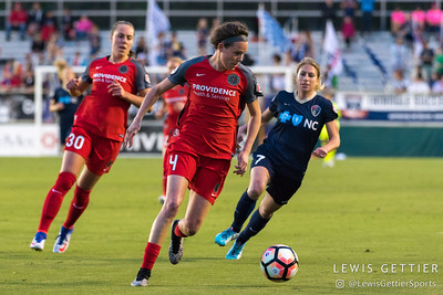 Emily Menges (4), Celeste Boureille (30), and McCall Zerboni (7) during a match between the NC Courage and the Portland Thorns in Cary, NC in Week 2 of the 2017 NWSL season. Photo by Lewis Gettier.