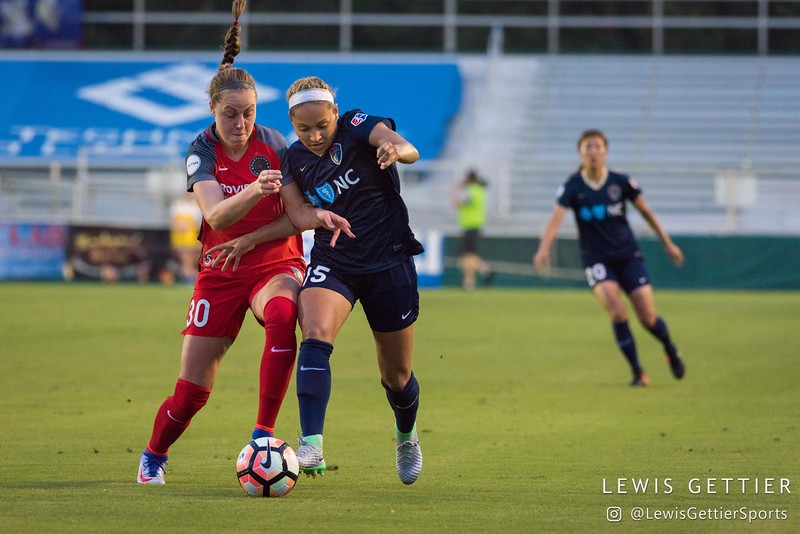 Celeste Boureille (30) and Jaelene Hinkle (15) during a match between the NC Courage and the Portland Thorns in Cary, NC in Week 2 of the 2017 NWSL season. Photo by Lewis Gettier.