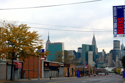 """Mile 14"" is in Long Island City Queens. You can see in the background the beautiful cityscape of Manhattan, across the East River, from the left the Empire State, the United Nation and the Chrysler Buildings."