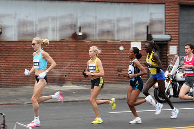 "PAULA RADCLIFFE 111 GBR Place 4 LUDMILA PETROVA 140 RUS Place 2 DERARTU TULU 117 ETH Place 1 WINNER SALINA      KOSGEI  112 KEN Place 70 CHRISTELLE DAUNAY 115 FRA Place 3  ""NEW YORK CITY MARATHON 2009""                                                     ""MILE 14 in Long Island City Queens"""