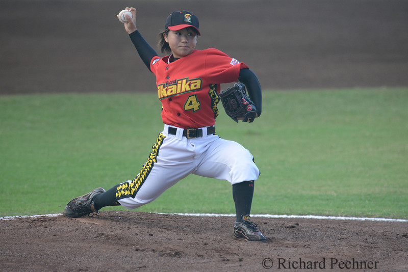 "Eri Yoshida serves up a 60 MPH knuckle ball in her 3rd win of the 2012 NAL Season at Ichiro Maehara Stadium in Wailuku, HI  on Saturday, June 23rd against the Sonoma County Grapes. Yoshida (3-0)  gave up 2 runs, both earned,  in 7 innings of work, throwing 70 pitches, 45 for strikes and finishing with a 2.74 ERA.  After the victory, Yoshida expressed confidence in her team's offense, noted that there were no errors ""behind her"" and was apologetic  for ""losing the two runs""."