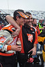 Joey Logano, foreground,  is Congratulated by Home Depot Crewmember Dave Hanson, after winning a rain-shortened Lenox Industrial Tools 301, at New Hampshire Motor Speedway, on June 28th, 2009.