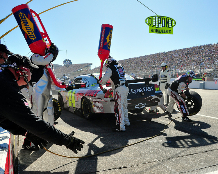 The crew of Jeff Gordon changes tires and fuels his #24 Dupont Chevrolet, during The Sylvania 300, at New Hampshire Motor Speedway, on Sept 20th.