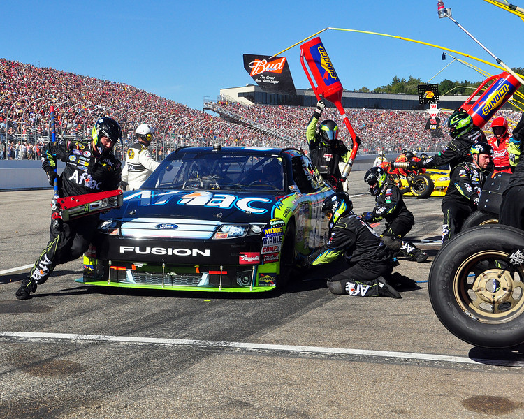Carl Edwards, in the #99 Aflac Ford Fusion, pulled his car into the pits for tires and fuel, during The Sylvania 300, at New Hampshire Motor Speedway, on September 20th, 2009