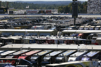 A zoom shot from the bleachers looking through the track infield area and to one of the camping areas, and beyond that, car parking