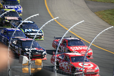 Juan Pablo Montoya and Tony Stewart jockey for the lead