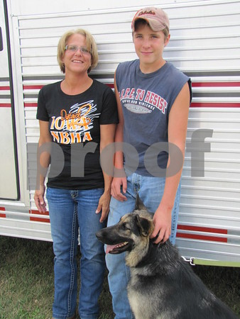 Kathy Arndorfer with her son, Grant, and 'Millie', were at the National Barrel Horse races to watch her daughter compete.