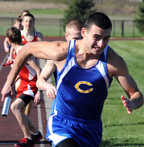 Clearview's RIcky Santos takes the handoff from Michael Holllingsworth in the boys 4X800 relay at Firelands on Apr. 5.  Steve Manheim