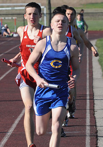 Clearview's Michael Hollingsworth runs first in the boys 4X800 meter relay at Nelson Howe Invitational at Firelands on Apr 5.   Steve Manheim
