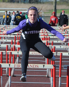 Keystone Emily Peters takes second place in girls 100M hurdles at Firelands on Apr. 4.  Steve Manheim