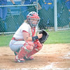Corey J. Corbin/NEWS<br /> Lady Lancers catcher Marissa Kirkwood looks into the dugout for the pitch call.