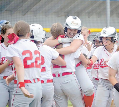 Corey J. Corbin/NEWS<br /> Neshannock celebrates Jenna DeLuca's game-tying three-run home run in the bottom of the seventh inning yesterday.