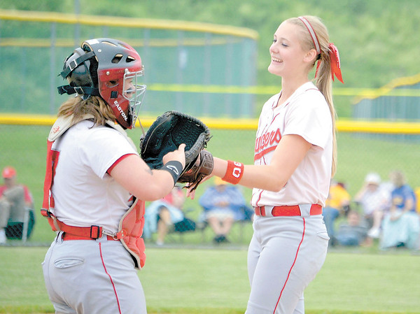 Corey J. Corbin/NEWS<br /> Neshannock catcher Marissa Kirkwood, left, shares a laugh with pitcher Madison Shaffer yesterday.