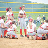 Corey J. Corbin/NEWS<br /> The Neshannock softball team looks on as teammate Kaela Zingaro is treated by the team's training staff in the eighth inning yesterday.
