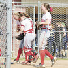 Members of the Neshannock High softball team celebrate their victory over Vincentian Academy.