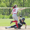 Madison Altmyer makes a throw to first base to turn a double-play. — Tiffany Wolfe