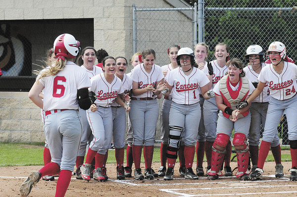 Members of the Neshannock High girls softball team greet Madison Shaffer as she makes her way to home plate following a grand slam. — Tiffany Wolfe