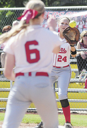 Alexandra Fischer waits for a throw at first base from pitcher Madison Shaffer. — Tiffany Wolfe