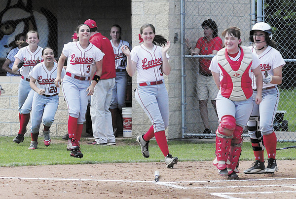 Members of the Neshannock High girls softball team cheer as Madison Shaffer makes her way to home plate after hitting a grand slam. — Tiffany Wolfe