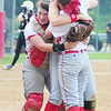 Teammates Marissa Kirkwood, Alexandra Fischer and Madison Altmyer embrace after the Neshannock girls softball team captured its second straight WPIAL title with an 8-5 win over South Side Beaver. — Tiffany Wolfe