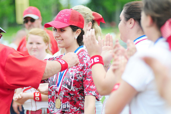 Team member Autumn Paolini, who has been battling an illness, receives her medal.  — Tiffany Wolfe