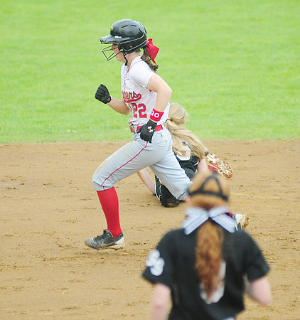 Madison Altmyer makes her way to third on a hit. — Tiffany Wolfe
