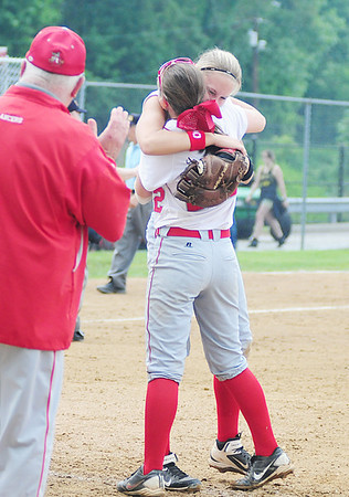 Teammates Alexandra Fischer and Madison Altmyer embrace after the Neshannock girls softball team captured its second straight WPIAL title with an 8-5 win over South Side Beaver. — Tiffany Wolfe