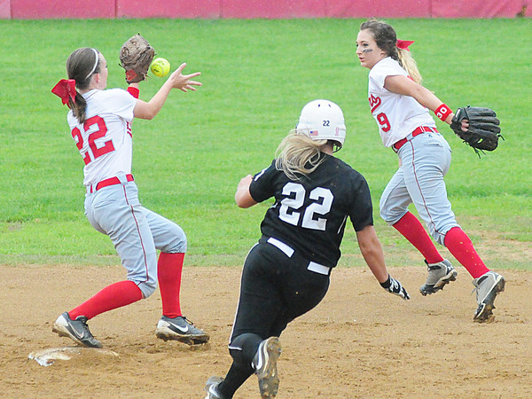 Neshannock shortstop Madison Altmyer, left, catches a toss from Marissa DeMatteo to tag out a South Side runner at second base.