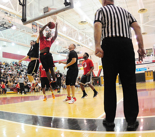 Malik Hooker, in red, and Jason Doneluk, in black, battle under the hoop. — Tiffany Wolfe