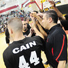 New Castle coach Ralph Blundo offers instruction to the black team. — Tiffany Wolfe