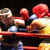 New England Golden Gloves boxing Open finals. Ashliegh Moore of Buzzards Bay (Blue corner), left, was winner over Lindsay Kyajohnian of Gorham, ME (Red corner) in 141 lb Women's Open. Referee is Dave Greenwood. (SUN/Julia Malakie)