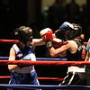 New England Golden Gloves Novice Finals. Danielle Millian of Waltham (Red) won by unanimous decision over Victoria Brohu of Boscawen, NH (Blue), in 119 lb Female Novice championship.  Referee is Lucy Miller. (SUN/Julia Malakie)