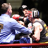 New England Golden Gloves boxing. Nathan Balakin of Tyngsboro and Central New England (Red), right, won 141 lb Novice semi-final over Joe Hoopaugh of Richmond, VT and Northern New England, when referee Rick Robitaille stopped the contest. [This was not stopping the contest] (SUN/Julia Malakie)