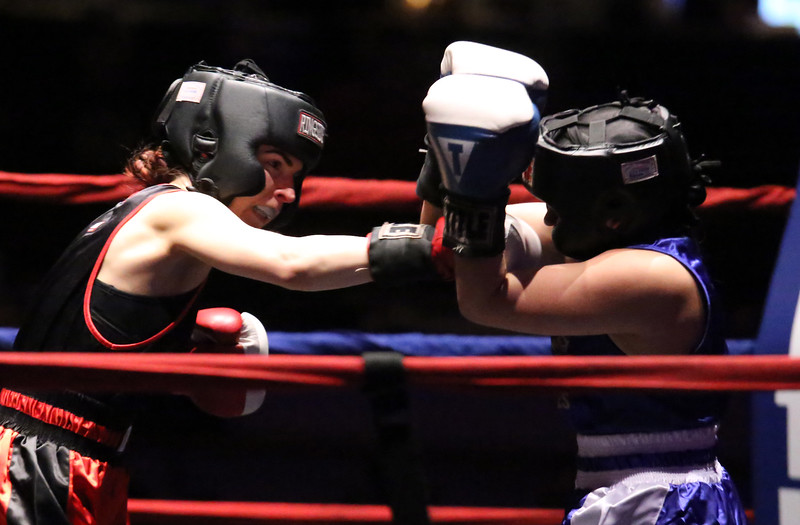 New England Golden Gloves boxing. Katherine Zehr of South Portland and Northern New England (Red), left, won by decision over Rianna Travaglini of East Hartford and Western New England, in 125 lb Female Novice semi-final. (SUN/Julia Malakie)