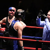 New England Golden Gloves boxing. Nathan Balakin of Tyngsboro and Central New England (Red) won 141 lb Novice semi-final over Joe Hoopaugh of Richmond, VT and Northern New England. Referee Rick Robitaille checks on Hoopaugh just before stopping the contest. (SUN/Julia Malakie)