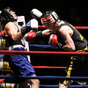 New England Golden Gloves boxing. Nathan Balakin of Tyngsboro and Central New England (Red), right, won 141 lb Novice semi-final over Joe Hoopaugh of Richmond, VT and Northern New England, when referee Rick Robitaille stopped the contest. (SUN/Julia Malakie)