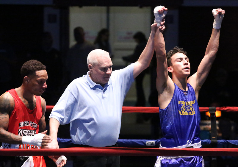 New England Golden Gloves boxing. Brian Zayas of Meriden, CT and Western New England (Blue) is declared the winner by unanimous decision over Troy Anderson of Dorchester and Central New England, in 132 lb Novice semi-final.  Referee isJackie Morrilll. (SUN/Julia Malakie)