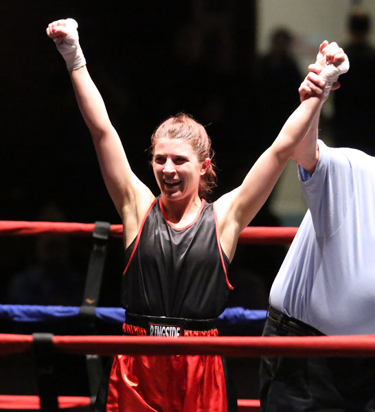 New England Golden Gloves boxing. Katherine Zehr of South Portland and Northern New England is declared winner by decision over Rianna Travaglini of East Hartford and Western New England, in 125 lb Female Novice semi-final. (SUN/Julia Malakie)
