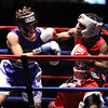 New England Golden Gloves boxing. Brian Zayas of Meriden, CT and Western New England (Blue), left, won by unanimous decision over Troy Anderson of Dorchester and Central New England (Red). (SUN/Julia Malakie)