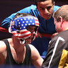 New England Golden Gloves boxing. Nathan Balakin of Tyngsboro and Central New England (Red), with trainer Brian Powers, right, and fighter Marquis Fowler, who was filling in in the corner, center, between rounds of 141 lb Novice semi-final vs Joe Hoopaugh of Richmond, VT and Northern New England. Balakin won when when referee Rick Robitaille stopped the contest. (SUN/Julia Malakie)