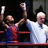 New England Golden Gloves boxing. Anderson Moreiro of Brockton & Southern New England (Red) is winner by 3-2 decision over Tashwan Ward of New London, CT and Western New England (Blue), in 123 lb Novice semi-final. Referee is Leo Gerstel. (SUN/Julia Malakie)