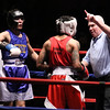 New England Golden Gloves boxing. Brian Zayas of Meriden, CT and Western New England (Blue), left, won by unanimous decision over Troy Anderson of Dorchester and Central New England, in 132 lb Novice semi-final.  Referee Jackie Morrilll checks on Anderson.  (SUN/Julia Malakie)