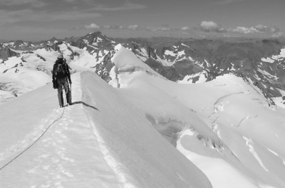 Andrew walking down Hochstetter Dome's SW Ridge.