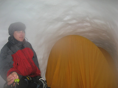 The tent pitched in the snow cave.