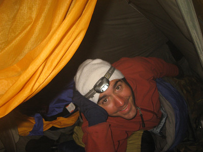 Trent in the tent, in the snow cave. We were protected by 7 layers. 1st thermals, 2nd silk bag, 3rd sleeping bag, 4th bivy bag, 4th inner tent, 5th outer tent, 6th snow cave, 7th the ridge protecting us from the full nor' west storm winds.
