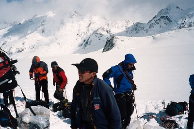 """Rope up for glacier travel! Check yourself, check your partner - then we'll check you"" Bill Atkinson repeated this constantly in an attempt to speed everyone up - it didn't work :). Taken Just after landing. Clint (left), Erwin, Tshering (foreground), and Richard. 19 Feb 04"